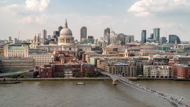 aerial time-lapse: pedestrian commuter crowd at millennium bridge with st paul's cathedral in london england uk - day stock videos & royalty-free footage