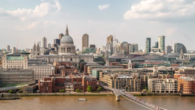 aerial time-lapse: pedestrian commuter crowd at millennium bridge with st paul's cathedral in london england uk - st. paul's cathedral london stock videos & royalty-free footage