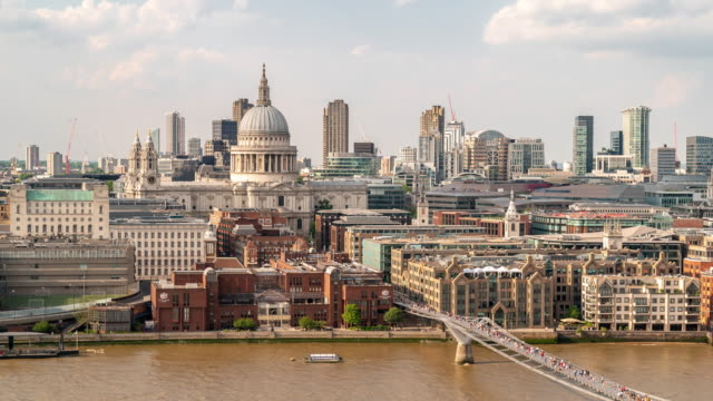 aerial time-lapse: pedestrian commuter crowd at millennium bridge with st paul's cathedral in london england uk - river thames stock videos & royalty-free footage