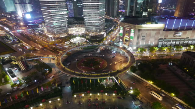 Aerial Timelapse, roundabout Zoom in, Pudong, night, traffic, city lights, Shanghai International Finance Centre, Shanghai, China
