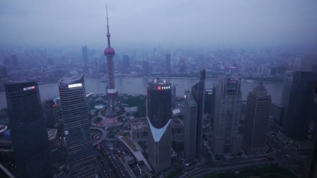 aerial timelapse shanghai - day to night from jin mao tower-  pudong, huangpu river, oriental pearl tower, skyline, city lights, streets, traffic, shanghai, china - spoonfilm stock-videos und b-roll-filmmaterial