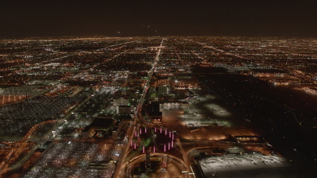 aerial timelapse showing airplanes landing at los angeles international airport at night. - lax airport stock videos & royalty-free footage