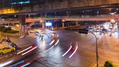 aerial time-lapse video: night traffic on junction in bangkok - traffic circle stock videos & royalty-free footage