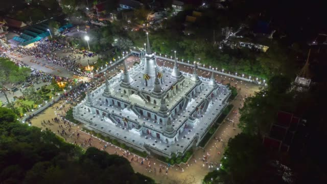 Aerial time-lapse view over big pagoda in Asokaram temple in Samutprakarn near Bangkok Thailand during Asalha Puja(Asanha Bucha)Buddhist festival which typically takes place in July, on the full moon.