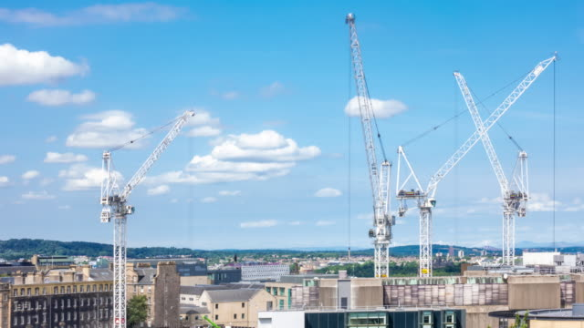 aerial time-lapse: working in construction site in edinburgh united kingdom - edinburgh scotland stock videos & royalty-free footage