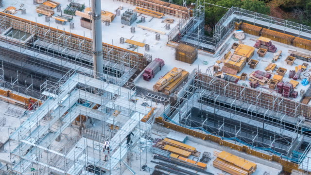 aerial time-lapse: working in construction site in tokyo - multiple exposure stock videos & royalty-free footage