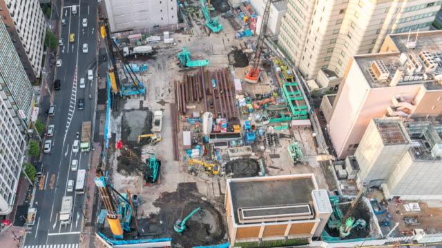 建設現場で働く空中時間経過。 - 建物の骨組み点の映像素材/bロール