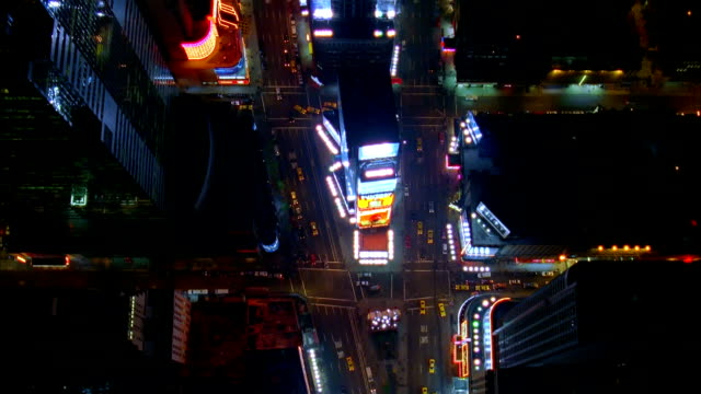 Aerial Times Square heading downtown at night/ New York, New York