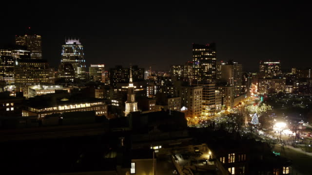 w/s aerial tl boston downtown skyline during christmas tree lighting ceremony. - クリスマスツリー点灯式点の映像素材/bロール