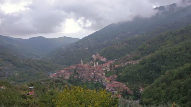aerial tl zoom in. medieval village of ceriana, italy - spoonfilm stock-videos und b-roll-filmmaterial