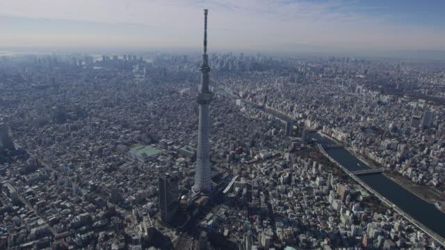 aerial tokyo skytree digital tv observation tower japan - microwave tower stock videos & royalty-free footage