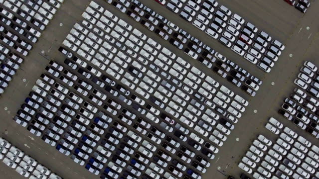 aerial top down bird view of new car storage parking lot - car plant stock videos & royalty-free footage