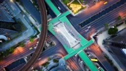 Aerial top down Hyper lapse of Traffic over big intersection bridges on Sathorn road in Bangkok. 4K aerial time lapse view by a drone over big intersection in Bangkok Thailand.