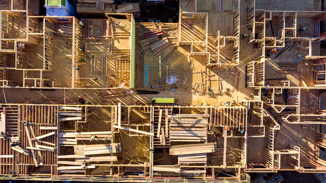 aerial top down hyperlapse of construction - wood material stock videos & royalty-free footage