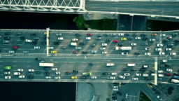 Aerial top down view of traffic jam on a car bridge and moving train. FullHD video