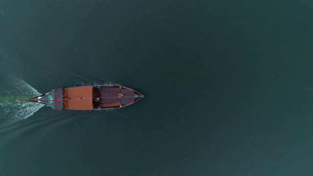 aerial top idyllic shot of nautical vessel moving in river during rainy season - porto, portugal - moving down stock videos & royalty-free footage