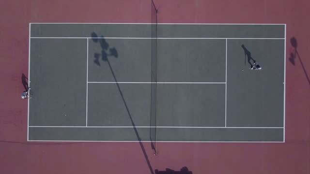 aerial top lockdown shot of tennis lawn on sunny day - karmiel, israel - courtyard stock videos & royalty-free footage