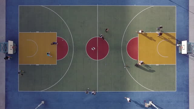 aerial top lockdown view of people on basketball court, drone flying over sports venue - hong kong, china - team sport stock videos & royalty-free footage