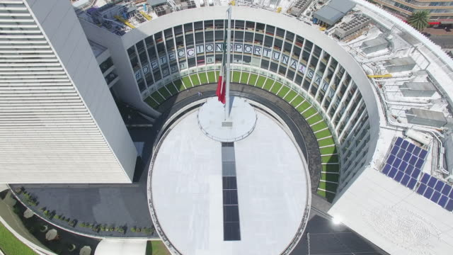 Aerial top of view of the Senado de la Republica's roof and the Mexican Flag in Reforma Avenue, Mexico City