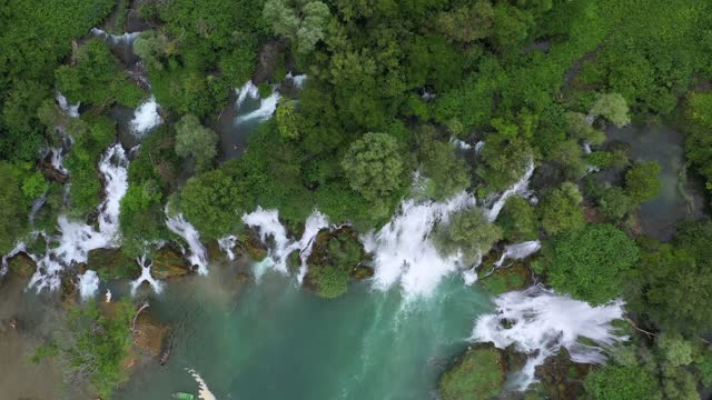 aerial top panning beautiful shot of kravice waterfall, drone flying over people exploring during vacation - studenci, bosnia and herzegovina - named wilderness area stock videos & royalty-free footage