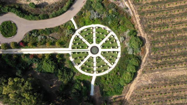 aerial top upward shot of water circle amidst rocks in park, drone flying on sunny day - golan, israel - built structure stock videos & royalty-free footage