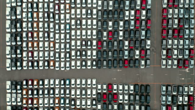 aerial top view car warehouse at loading dock waiting load to carrier ship for shipping to worldwide. - large group of objects stock videos & royalty-free footage