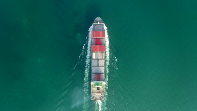aerial top view container cargo ship carrier container on the sea for logistics business , shipping , import export or transportation. - vertical stock videos & royalty-free footage