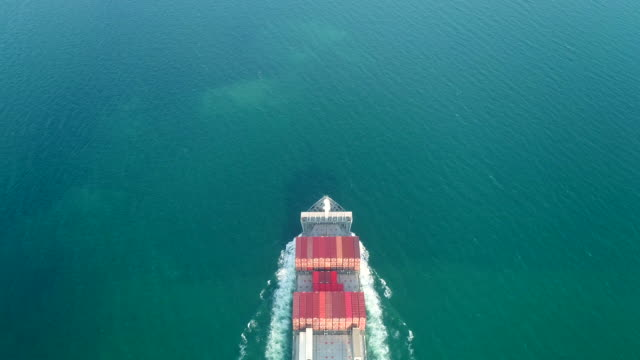 aerial top view container cargo ship carrier container on the sea for logistics business , shipping , import export or transportation. - container stock videos & royalty-free footage