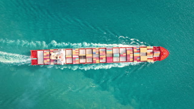 aerial top view container cargo ship full speed with carrier container on the sea for business logistic, import export shipping or transportation. - turquoise coloured stock videos & royalty-free footage