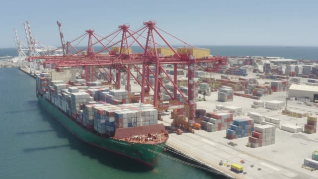 aerial top view container cargo ship in import export business logistic and transportation of international by container cargo ship in the open sea - stabilimento per il trasporto video stock e b–roll