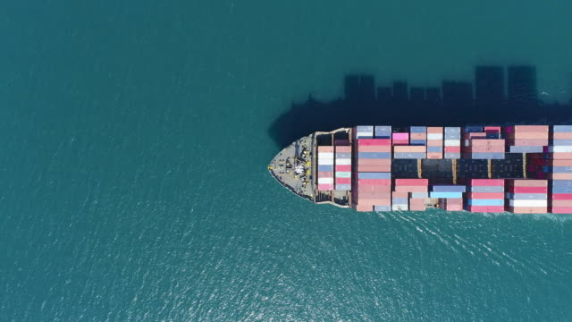 aerial top view container ship driving on the sea for logistic import export or transportation. - shipping stock videos & royalty-free footage