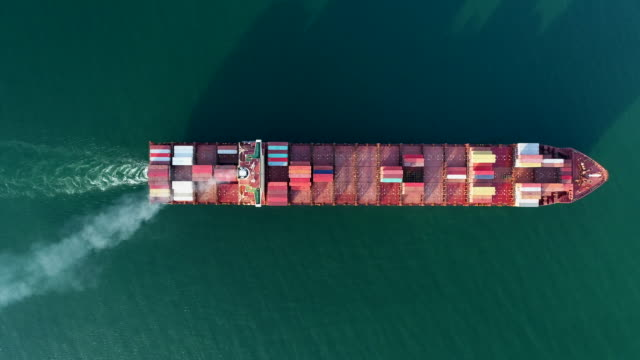 vidéos et rushes de aerial top view container ship on the sea going to quayside for logistics , shipping , import export or transportation. - faire fonctionner