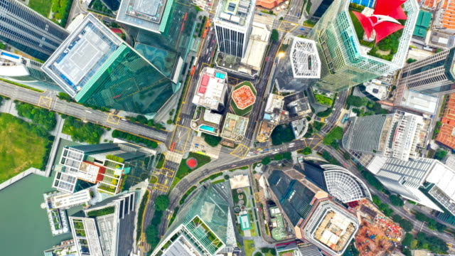aerial top view drone-lapse or time-lapse of financial central business district building of singapore city at day - hyper lapse stock videos & royalty-free footage