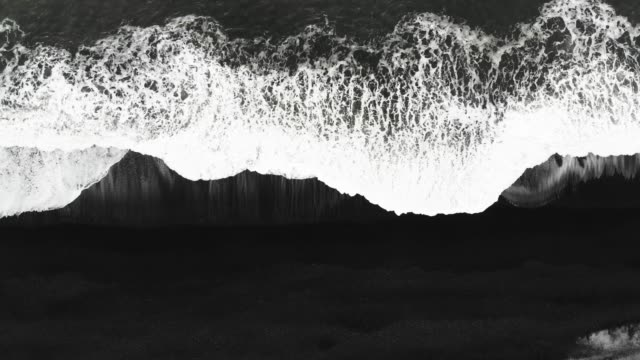 aerial top view of beautiful black sand beach and waves in iceland - high contrast stock videos & royalty-free footage