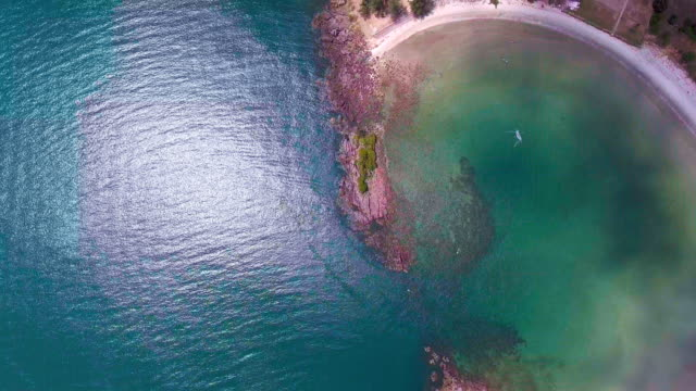 Aerial Top View of Beautiful Tropical Curved Beach with White Sand