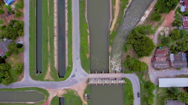 aerial top view of channels for irrigation in rural area - diga video stock e b–roll