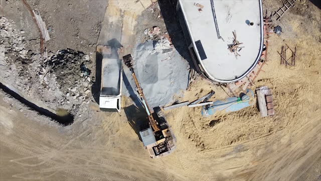 aerial top view of excavator working in construction site. - quarry stock videos & royalty-free footage