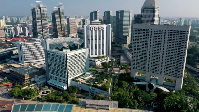 aerial top view of financial central business district building of singapore city at day - formal garden stock videos & royalty-free footage