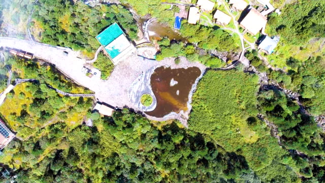 Aerial Top View of Lake and Dwelling House on Tropical Mountain with Moving Cloud, Guizhou Province, China