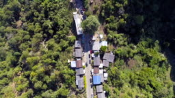 Aerial top view of small village on the mountain in the morning