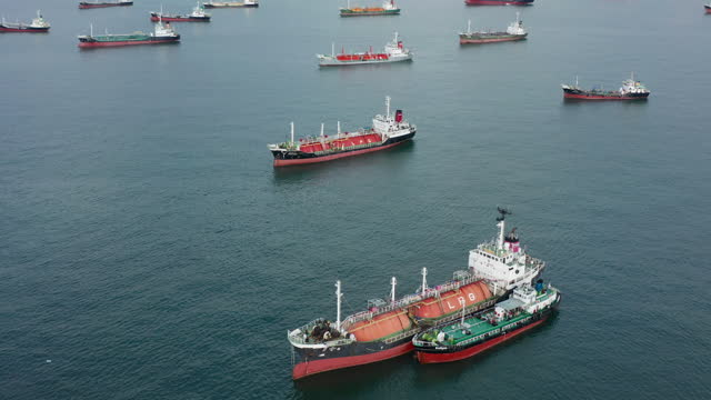 aerial top view of the ship carrying the lpg and oil tanker in the sea port - storage tank stock videos & royalty-free footage