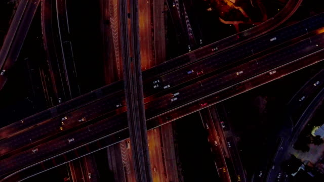 Aerial top view of traffic light on the highway at dusk