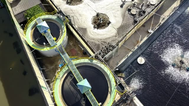 vidéos et rushes de aerial top view of waste water treatment system in industrial estate. - station