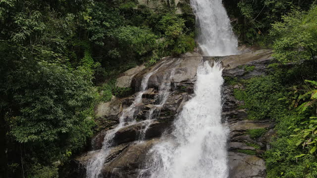 aerial top view of waterfall in the tropical - named wilderness area stock videos & royalty-free footage