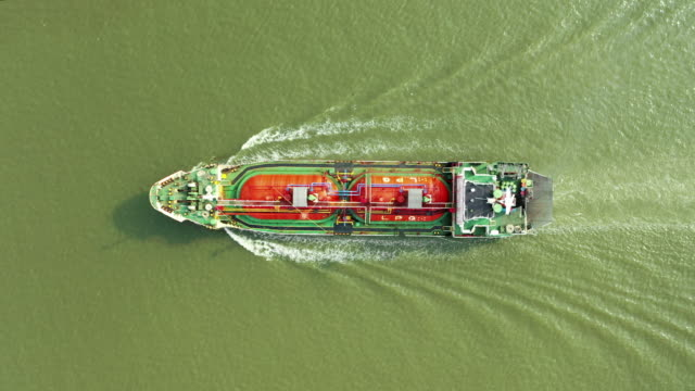 aerial top view oil ship tanker full speed with beautiful wave pattern for transportation or energy concept background. - tanker stock videos & royalty-free footage