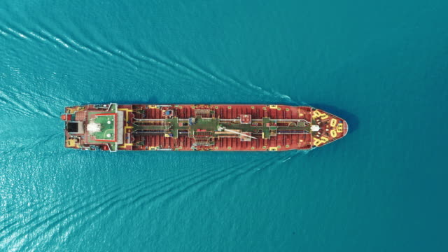 aerial top view oil ship tanker full speed with beautiful wave pattern for transportation oil from refinery on the sea. - gas stock videos & royalty-free footage