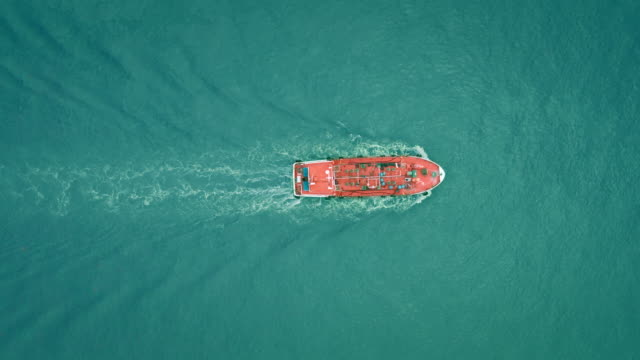 aerial top view oil ship tanker full speed with beautiful wave pattern for business logistics, import export shipping or freight transportation. - tank stock videos & royalty-free footage