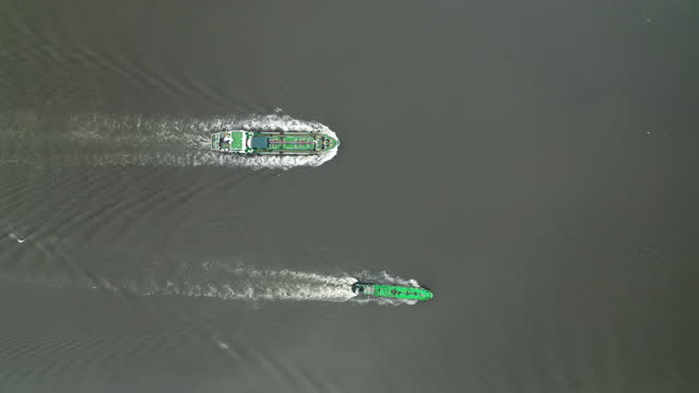aerial top view oil ship tanker full speed with beautiful wave pattern transportation oil from refinery on the river. transportation or energy concept background. - two objects stock videos & royalty-free footage