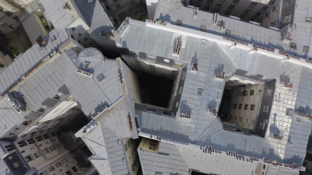 vidéos et rushes de aerial top view: roofs of neat houses - paris, france - paris