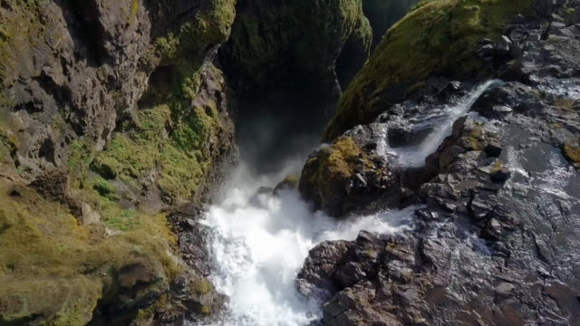 vídeos y material grabado en eventos de stock de aerial top view: stunning glymur waterfall in amazing canyon, hvalfjordur, iceland - top view